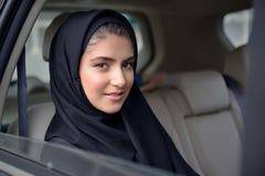 Emarati Arab Business woman in the car Stock Images