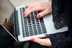 Emarati Arab Business woman using laptop computer Royalty Free Stock Photos
