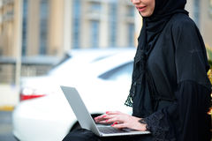 Emarati Arab Business woman using laptop computer Stock Images