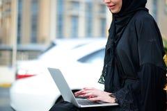 Emarati Arab Business woman using laptop computer Stock Images