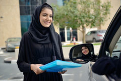 Emarati Arab Business women getting into the car Royalty Free Stock Photos