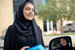 Emarati Arab Business women getting into the car Stock Photos