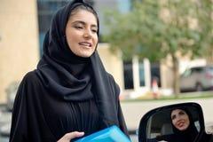 Emarati Arab Business women getting into the car Stock Photos