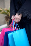 Emarati Arab woman coming out of shopping Royalty Free Stock Photo