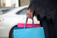 Emarati Arab woman coming out of shopping Royalty Free Stock Photos