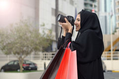 Emarati Arab woman coming out of shopping Stock Photography