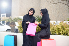 Emarati Arab women coming out of shopping Stock Images