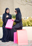 Emarati Arab women coming out of shopping Royalty Free Stock Images