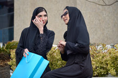 Emarati Arab women coming out of shopping Royalty Free Stock Photos