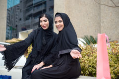 Emarati Arab women coming out of shopping Royalty Free Stock Photography
