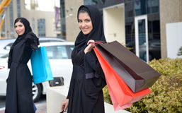 Emarati Arab women coming out of shopping Stock Photography