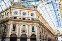 Emauele Vittorio galery in Milan Italy. Inside with a lot of windows and blue sky and painting on the wall royalty free stock photo