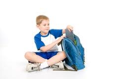 Embalagem da criança para a escola Fotografia de Stock Royalty Free