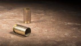 Embalagens gastas de um revólver 45 semi automático Imagem de Stock Royalty Free