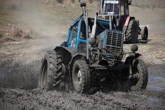 Emballage de boue de tracteur Photo stock