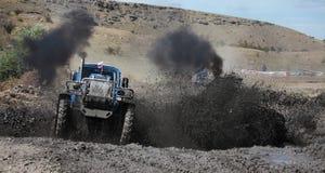 Emballage de boue de tracteur Photographie stock libre de droits