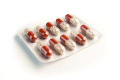 Emballage transparent de pillules rouges   Image stock