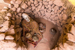 Embalmed mummy and skull in Peru. Stock Photo