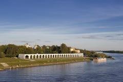 Embankment. Veliky Novgorod embankment  at summer time with view of Yaroslav Courtyard over Volhov RIver Stock Photo