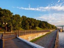 Quay of the river. Grass, water, Church, Yaroslavl stock photo