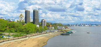 Embankment of the Amur River with new buildings and pleasure boa Royalty Free Stock Image