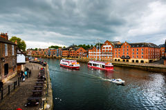 Embankment area of Ouse river in York, UK. York, UK. Embankment area of Ouse river in York, UK. Heavy clouds and touristic boats Royalty Free Stock Photo
