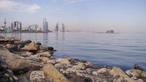 Embankment of Baku, Azerbaijan. The Caspian Sea, Stones and Skyscrapers stock video footage