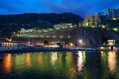 Meta di Sorrento, southern Italy. Embankment and beach of Meta di Sorrento at night, southern Italy Stock Photo