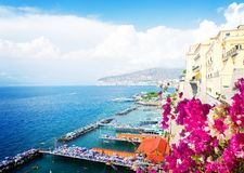 Sorrento, southern Italy. Embankment and beach of Sorrento with flowers, southern Italy, retro toned stock photo