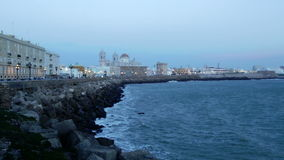 Embankment and Cathedral in  evening time. Cadiz stock footage