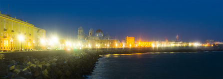 Embankment and Cathedral in night. Cadiz Royalty Free Stock Photo