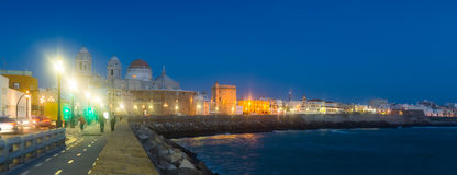 Embankment and Cathedral in night. Cadiz Stock Photo