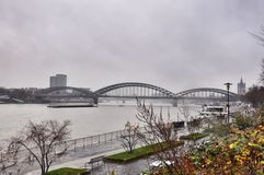 Embankment in Cologne and the railway bridge - Gegentsollernov, Germany Royalty Free Stock Image