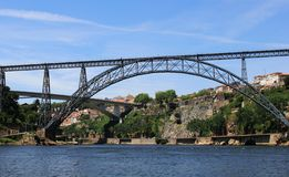 Embankment of Douro River with Bridge of Luis I and Prince Henry Bridge in Porto stock images