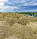 The embankment formed by piles of small crushed stone from limestone. Quarries for the extraction of limestone. The embankment formed by piles of small crushed royalty free stock photography