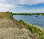 The embankment formed by piles of small crushed stone from limestone. Quarries for the extraction of limestone. The embankment formed by piles of small crushed stock photography