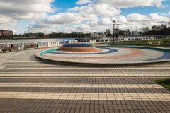 Embankment with a fountain. Quay of the Lower Pond in Kaliningrad with a fountain. Fountain without water, because it`s still spring Stock Photo
