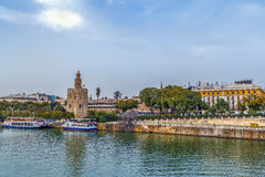The embankment of the Guadalquivir river, Seville. The embankment of the Guadalquivir river in Seville with Torre del Oro, Spain stock image