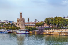 The embankment of the Guadalquivir river, Seville. The embankment of the Guadalquivir river in Seville with Torre del Oro, Spain stock photography