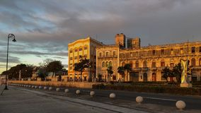 Embankment of Havana in early morning with the house that illuminates the morning sun, Cuba royalty free stock photos