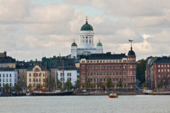 Embankment in Helsinki with a kind on a cathedral Royalty Free Stock Image