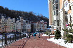 Embankment and hotels at the foot at the mountains, Rosa Khutor. Stock Image
