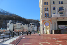Embankment and hotels at the foot at the mountains, Rosa Khutor. Stock Photos