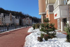 Embankment and hotels in the ski village Rosa Khutor Stock Photos