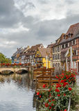 Embankment of  Lauch River, Colmar, France. Embankment of  Lauch River with historical houses in Colmar, Alsace, France Stock Photography