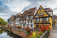 Embankment of  Lauch River, Colmar, France. Embankment of  Lauch River with historical houses in Colmar, Alsace, France Royalty Free Stock Photos