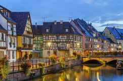 Embankment of  Lauch River, Colmar, France. Embankment of  Lauch River with historical houses in Colmar, Alsace, France. Evening Royalty Free Stock Photography