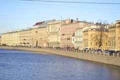 Embankment. In the light of the evening sun on the streets of St. Petersburg Stock Photos