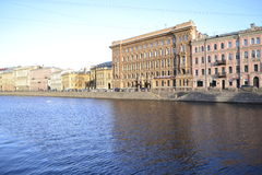 Embankment. In the light of the evening sun on the streets of St. Petersburg Stock Image