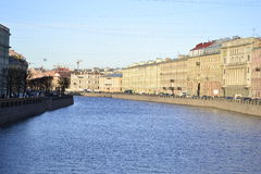 Embankment. In the light of the evening sun on the streets of St. Petersburg Royalty Free Stock Photo